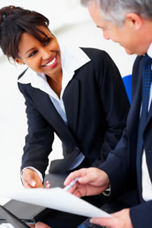 Business woman assisting businessman
