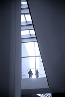Two business men in a modern, elegant building.